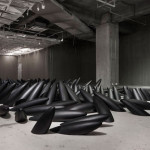 Karesansui – Pitch-black sprawling limbs in the gallery's floors and walls